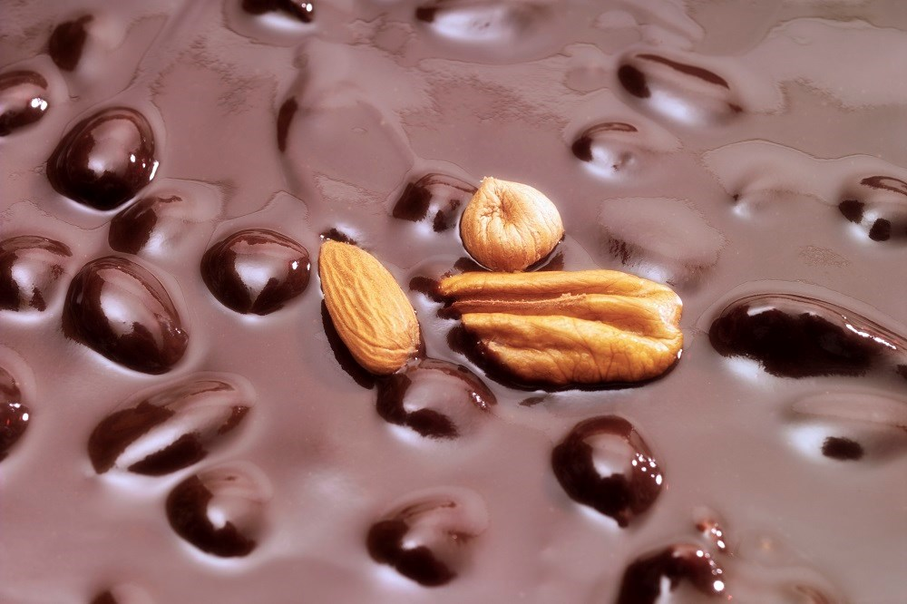 The 4 isocaloric, weight maintenance diets included the average American diet, almonds, cocoa powder and dark chocolate.