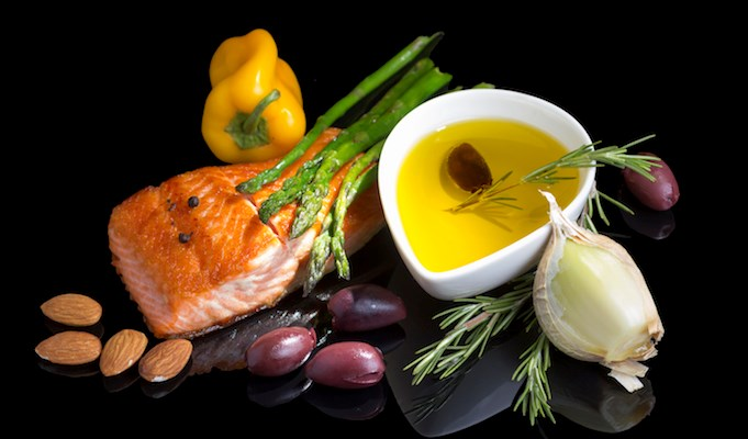 Study finds that closely adhering to a Mediterranean-style diet possibly protects men from aggressive and advanced prostate cancer.