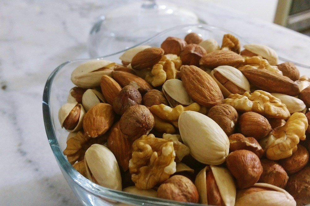 Participants with type 2 diabetes were randomly assigned to a full-dose nut diet, full-dose muffin diet, or half-dose nut diet.