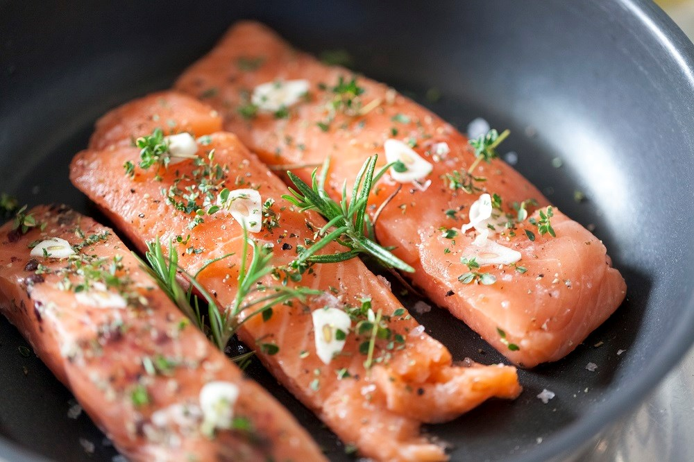 The AHA recommended consuming 2 servings of 3.5 ounces of oily fish per week.